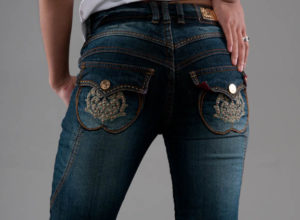 jeans with curved back pockets in dark wash