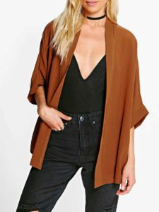 Camel color worn with black jeans