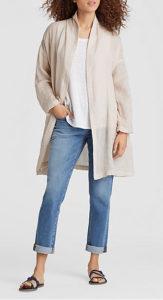 Soft beige, light jacket black jeans outfit idea