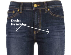 resin set wrinkles on jeans close-up