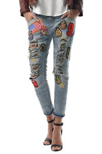 Distressed jeans embellished with patches