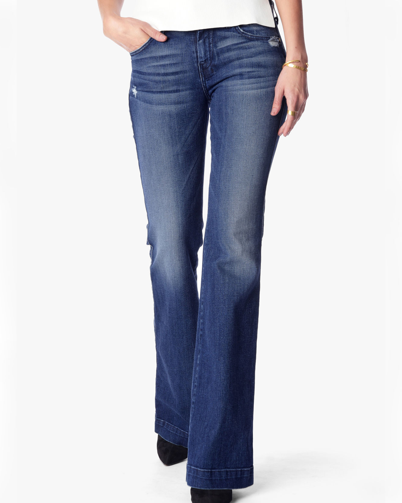 jeans with fading and whiskers on thighs
