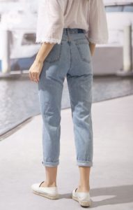 light wash mom jeans with distressing - back view
