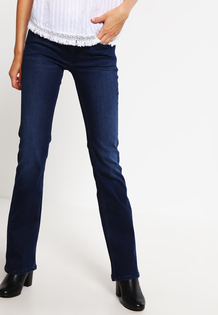 mid rise bootcut jeans with a lighter top