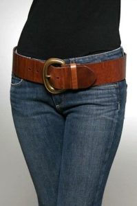 wide belt worn at hip level with jeans
