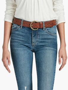 a wide belt worn with jeans shortens a long torso