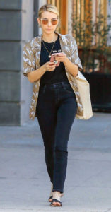 Emma Roberts wears black jeans with neutral top