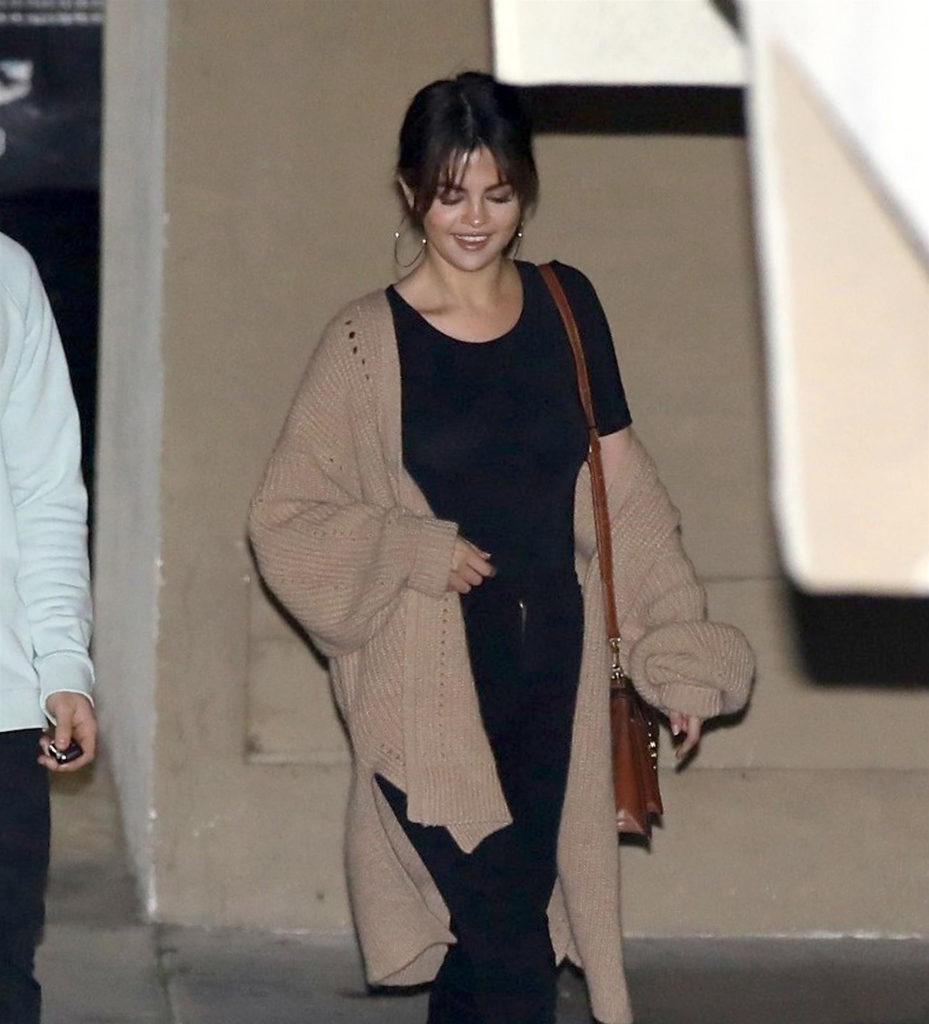 Selena Gomez wears black jeans outfit
