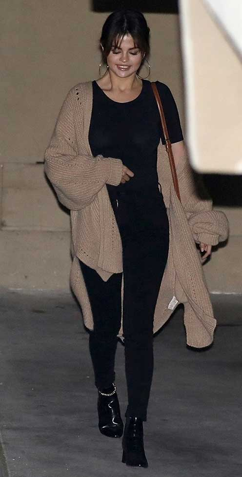Selena Gomez wears black jeans outfit with neutral top