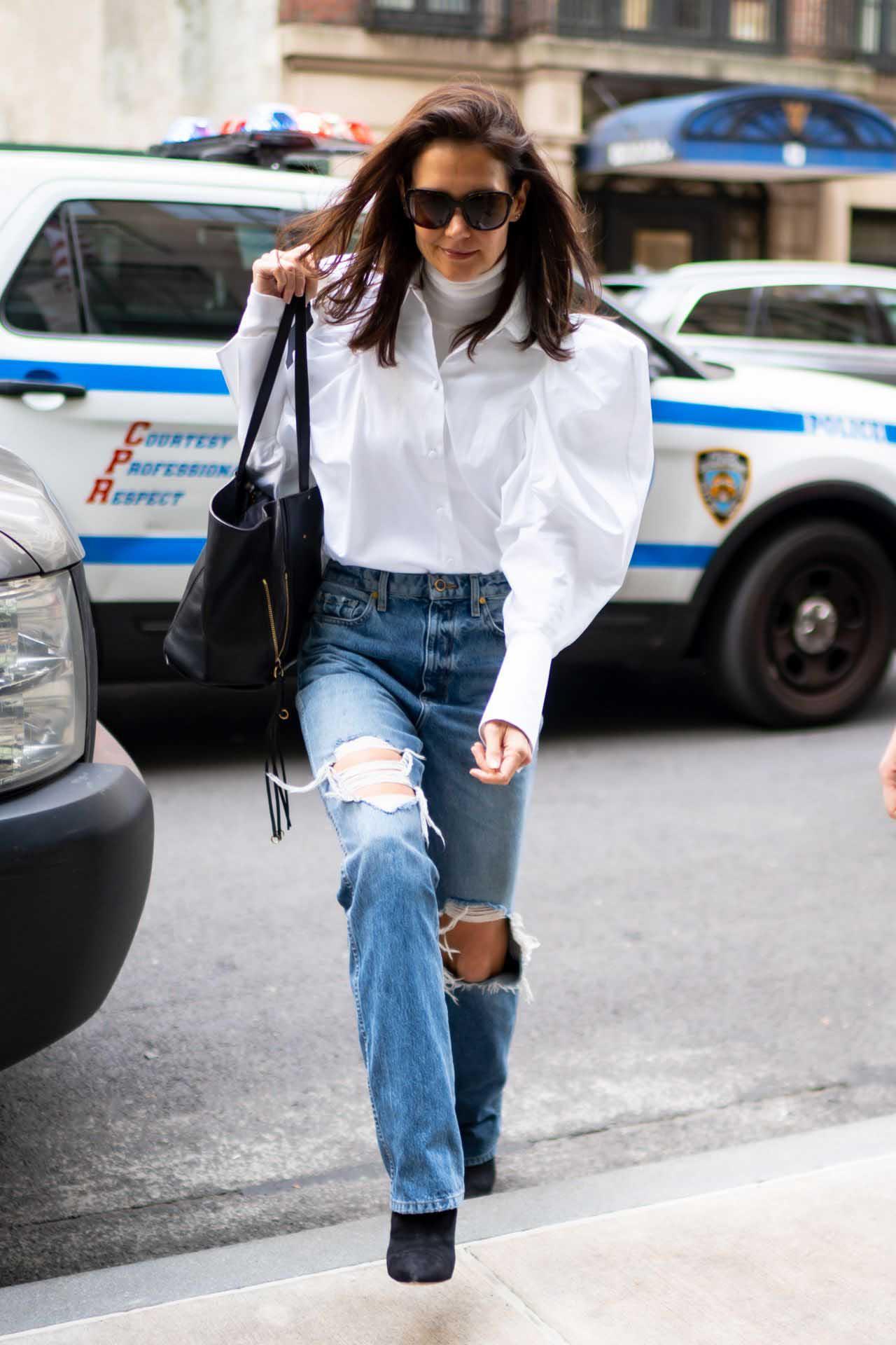 Katie Holmes, Khaite distressed jeans, Khaite puffy sleeve shirt